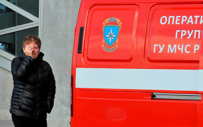 A woman wipes her tears outside Pulkovo